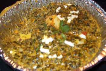 Saag Paneer, my absolute favorite: Spinach and homemade cheese cubes cooked in flavorful spices.  It makes cream of spinach almost taste like a rank amateur.